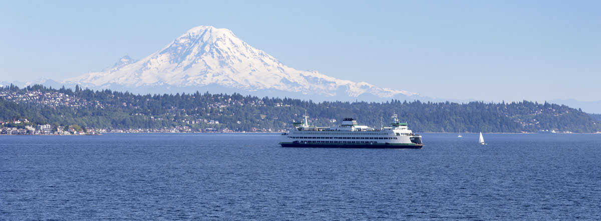 Ferry moving across Puget Sound with Mt. Rainier prominent in the background.